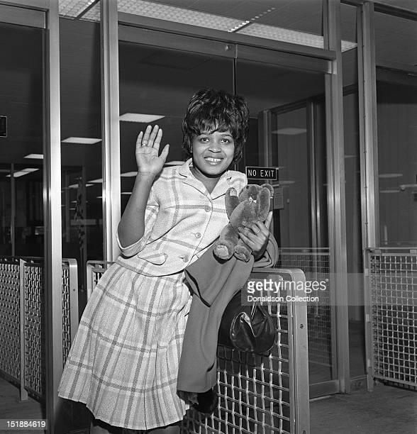 Library file dated of pop stars Little Eva and Brian Hyland boarding a flight for New York Little Eva the singer who took The Locomotion to the top...