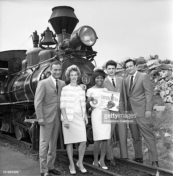 Little Eva poses for a portrait with LR producer Al Nevins songwriter Carole King Little Eva songwriter Gerry Goffin and producer Don Kirshner on...