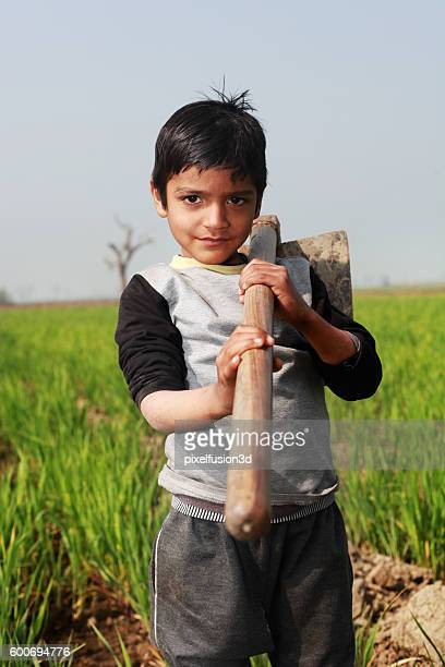 little farmer - child labour stock pictures, royalty-free photos & images