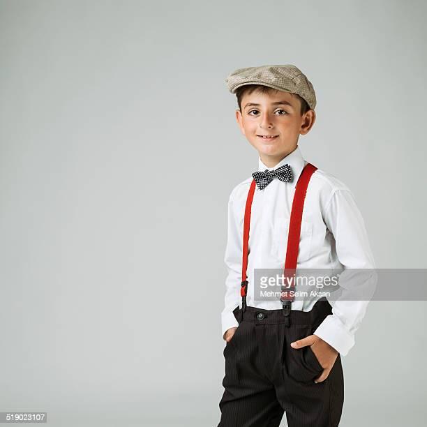 little fashion model with newsboy cap - サスペンダー ストックフォトと画像