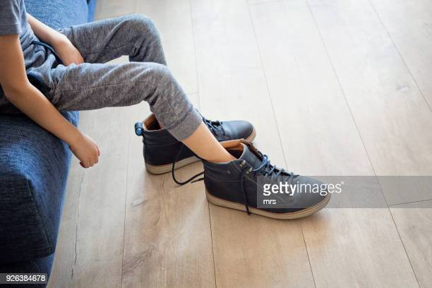 little feet, big shoes - big foot stock photos and pictures