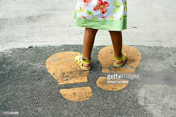 little feet on giant footprints - big foot stock photos and pictures