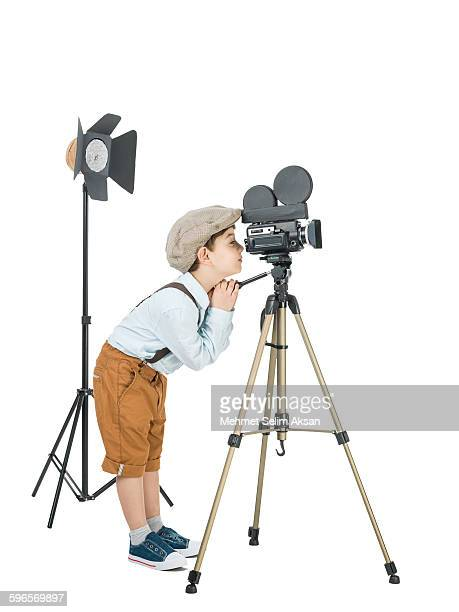 Little film director posing with video camera