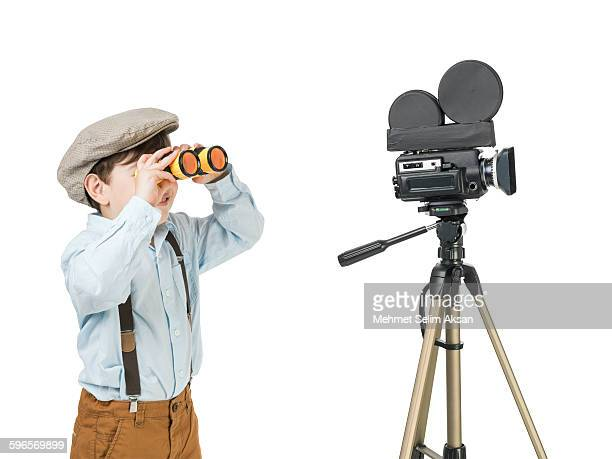 little film director posing with video camera - blue film images stock photos and pictures