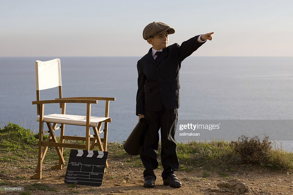 Little Film Director Shouting With Megaphone In Outdoor Set : Stock Photo