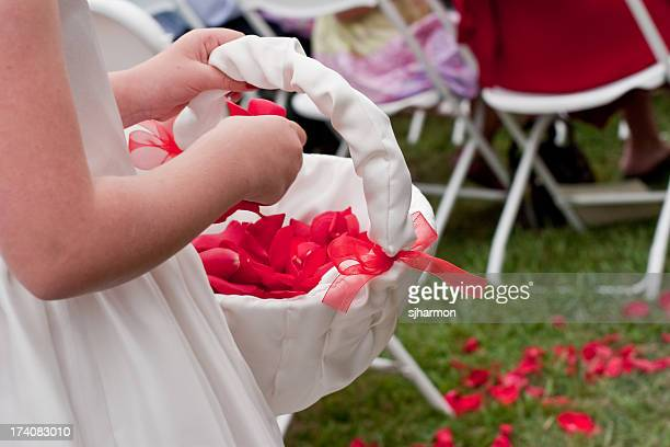 Little Flower Girls Tossing Rose Petals During Wedding Ceremony