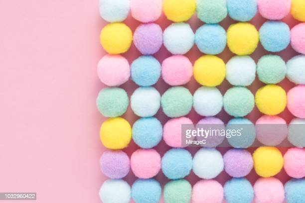 little fluffy pom-pom balls - pom pom stock pictures, royalty-free photos & images
