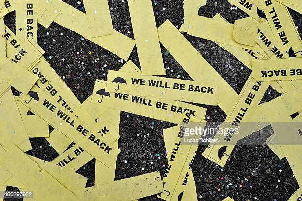 Little flyers on the ground promise that Umbrella Revolution protesters will be back after the clearance of Occupy Central Prodemocracy camp in...