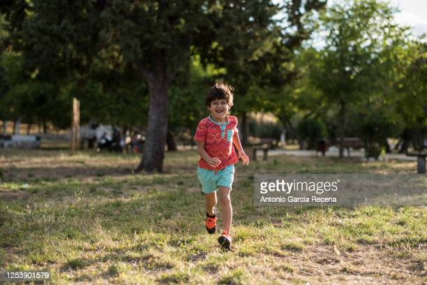 little four years old running boy in outdoors park - 4 5 years stock pictures, royalty-free photos & images
