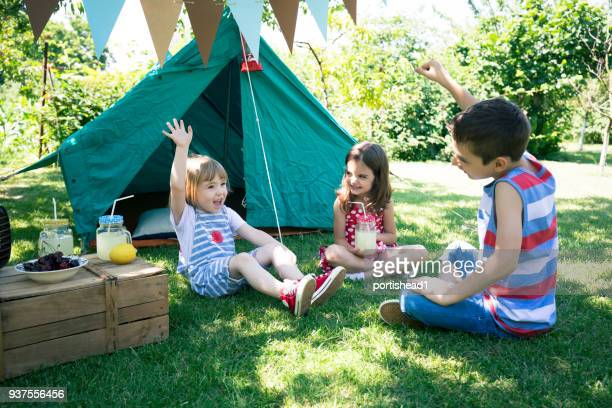 little friends having backyard party - camping stock photos and pictures