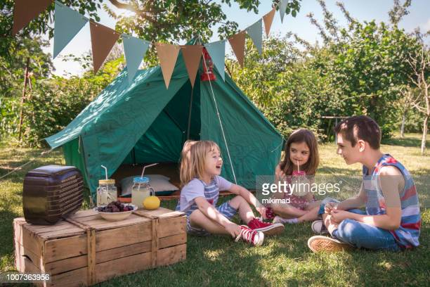 little friends having picnic - backyard party stock pictures, royalty-free photos & images