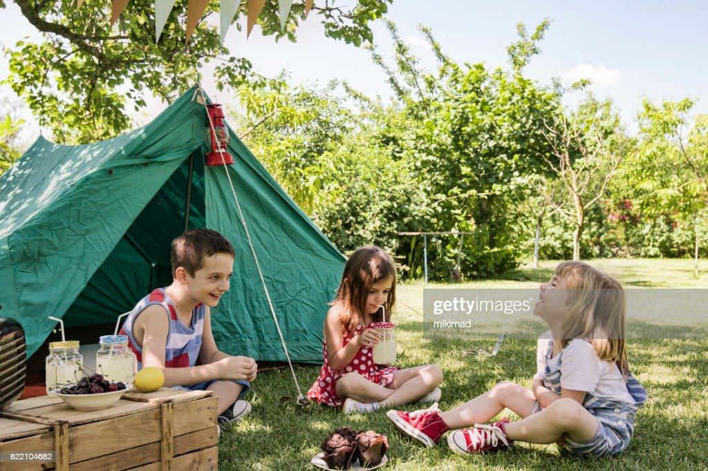 Little friends having picnic : Stock Photo