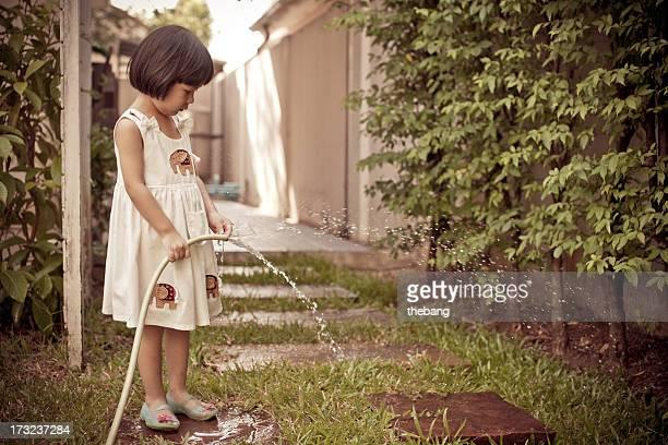 Little gardener watering flowers