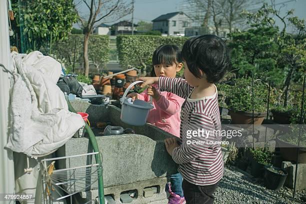 little gardeners - peter lourenco stock-fotos und bilder