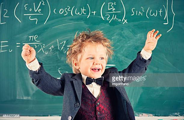 little genius solving mathematical equation - physicist stock photos and pictures