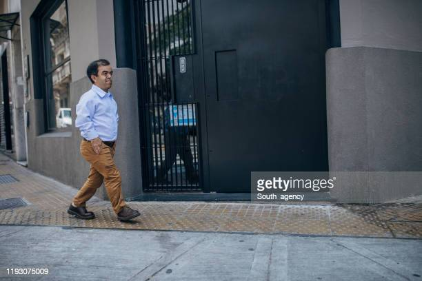 little gentleman walking on the street alone - dwarf man stock pictures, royalty-free photos & images