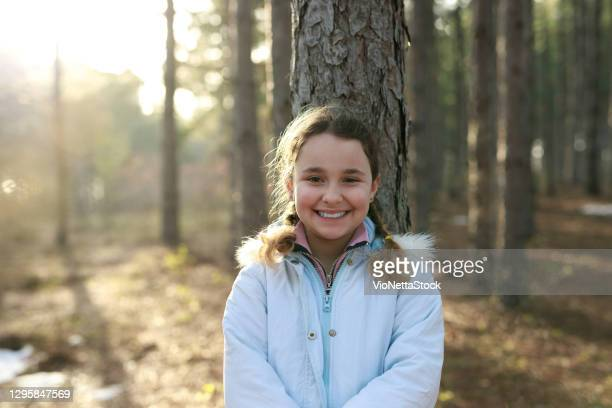 little girl 10-14 years smiling and looking at the camera - 10 11 years stock pictures, royalty-free photos & images