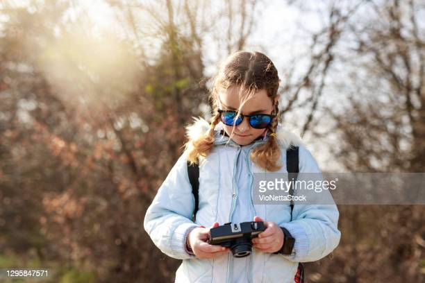 little girl 10-14 years with camera in nature - stock photo - 10 11 years stock pictures, royalty-free photos & images