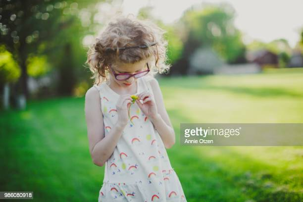 Little girl and a Dandelion