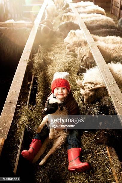 A little girl and a little lamb
