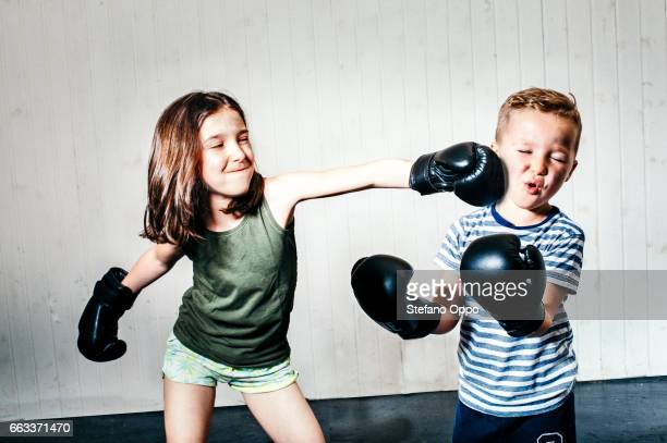 Little girl and boy boxing