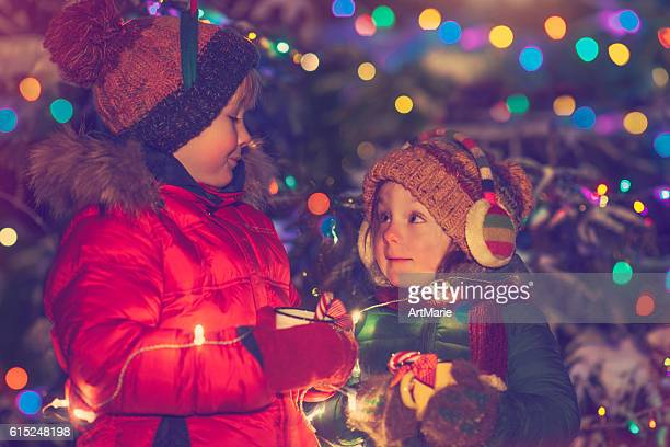 Little girl and boy in Xmas