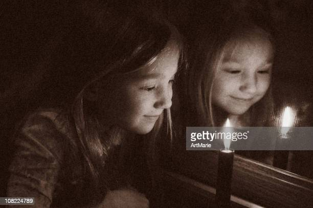 little girl and candle in retro style - girl in mirror stock photos and pictures