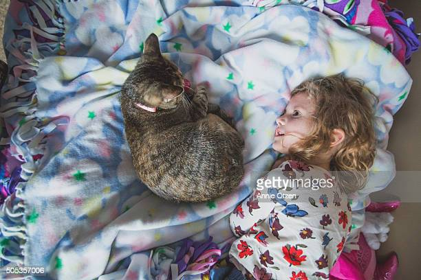Little Girl and Cat on Bed