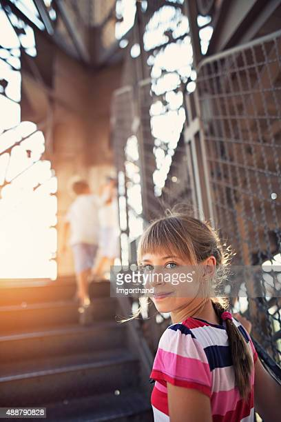 Little girl and her brothers climbing stairs of Eiffel Tower