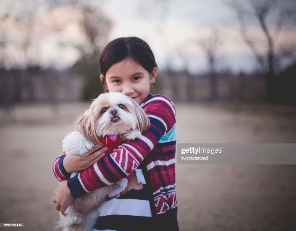 Little girl and her dog : Stock Photo