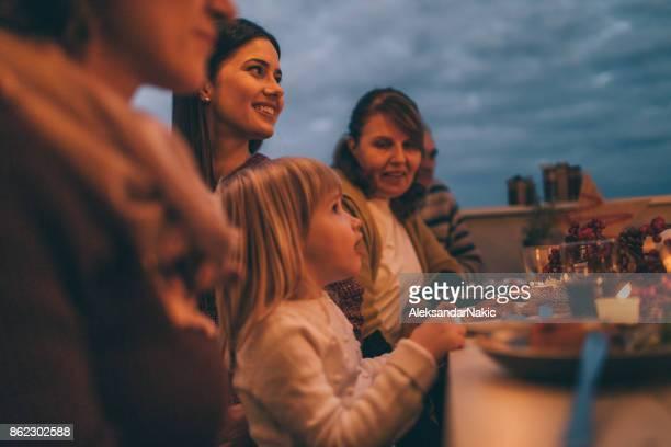 Little girl and her mom at Thanksgiving dinner