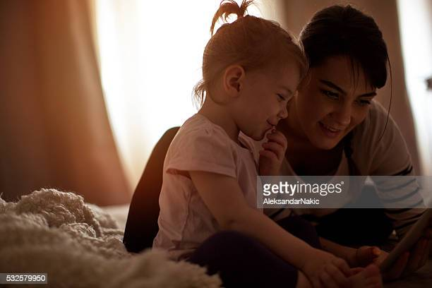 Little girl and her mother enjoying their morning routine