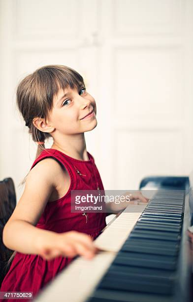 little girl and her piano - pianist front stock pictures, royalty-free photos & images
