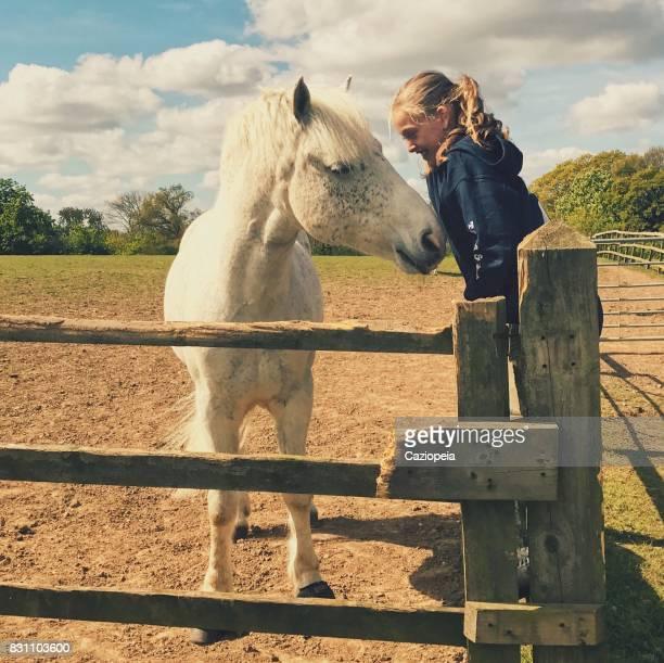 liten flicka och hennes ponny - pony play bildbanksfoton och bilder