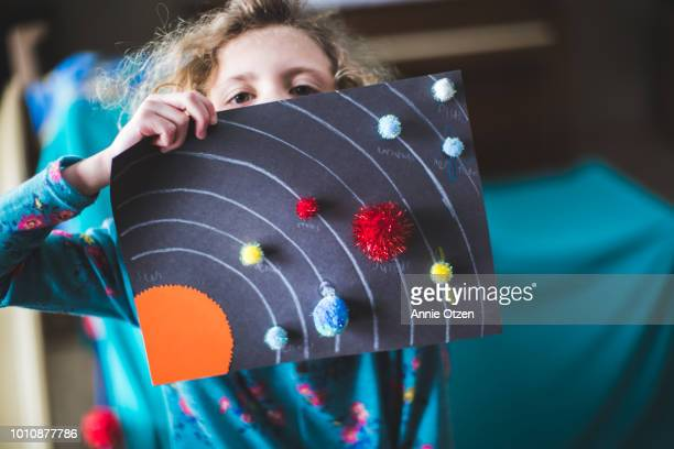 little girl and her solar system art project - art and craft ストックフォトと画像