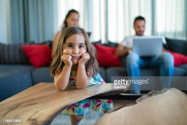 little girl and her uninterested family - ignoring stock pictures, royalty-free photos & images