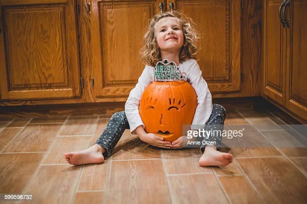 Little Girl and Jack-O-Lantern