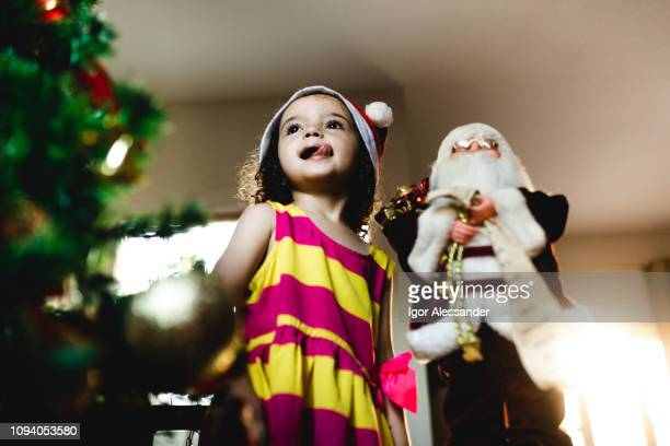 Little girl and Santa Claus doll