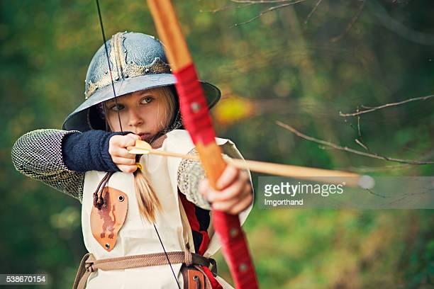 Little girl archer aiming