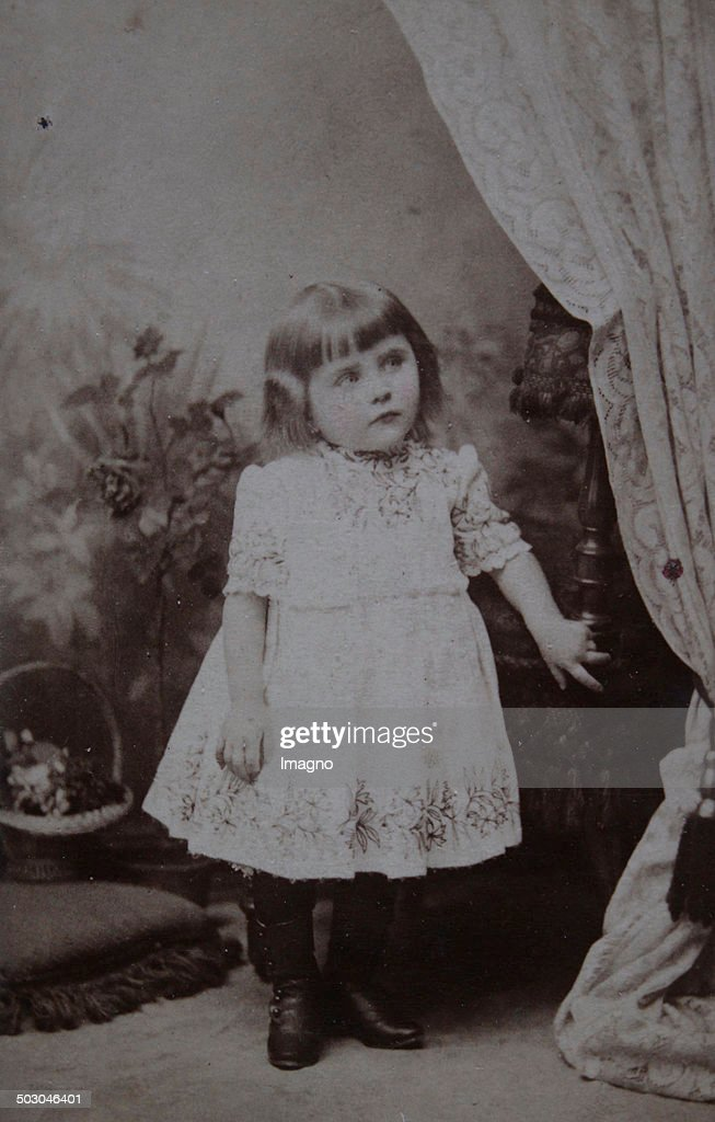 Little Girl Around The Age Of 3 Years In A White Dress About 1900