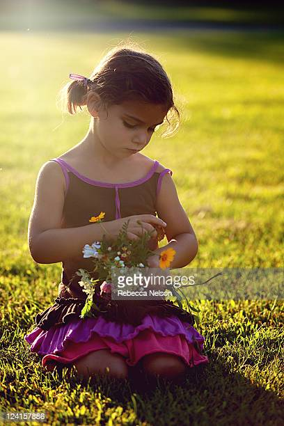 little girl arranging her bouquet - rebecca nelson stock pictures, royalty-free photos & images