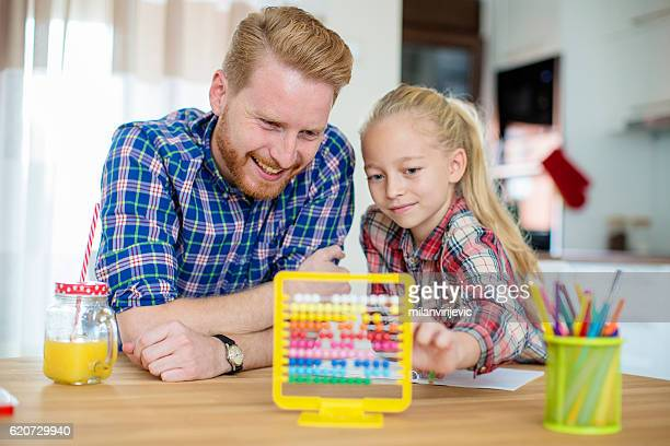 Little girl asks for dads help with homework
