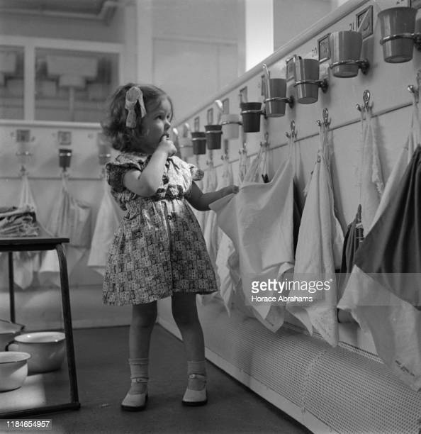 A little girl at a day nursery in Tottenham London during World War II June 1941