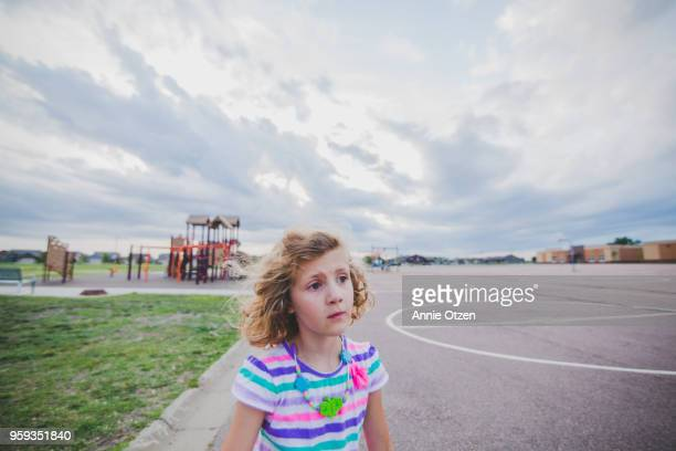 Little girl at a schoolyard
