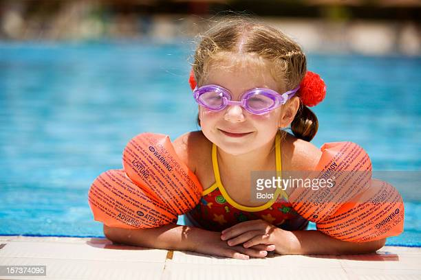 little girl at edge of pool - armband stock pictures, royalty-free photos & images