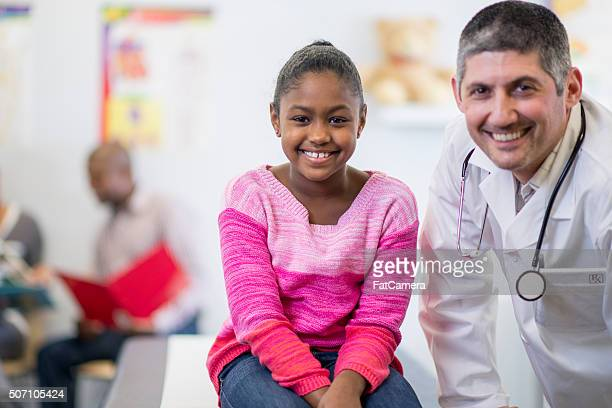 Little Girl at Her Check Up with the Doctor