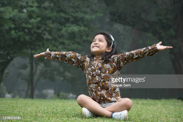 little girl at playground outdoors in summer stock photo - children only stock pictures, royalty-free photos & images