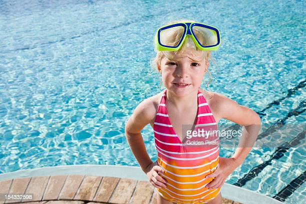 little girl at side of pool ready to swim - golden goggles stock pictures, royalty-free photos & images