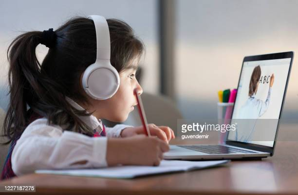little girl attending to online school class - e learning stock pictures, royalty-free photos & images