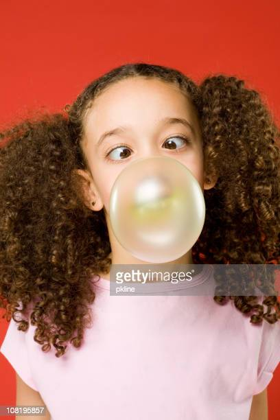 Little Girl blowing a bubble